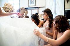 bridesmaids assisting bride getting ready twin oaks garden estate bridal suite