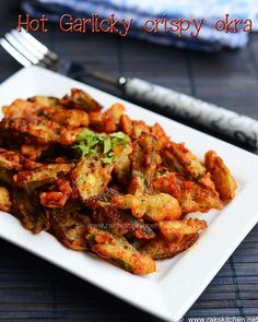 Crispy okra (Ladies fingers) tossed in a spicy, garlicky sauce – dry version. With step by step pictures!