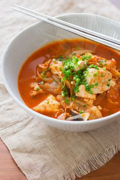 Kimchi Jjigae (김치 찌개) is a spicy Korean stew made with fermented kimchi, pork belly and tofu. Learn the secrets for the best Kimchi Jjigae with this recipe.