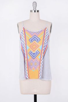 Printed ladder back colorful boho top. Adjustable straps 100% Rayon Size Chart: Small: 2/4 Medium: 6/8 Large: 10