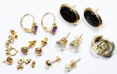 Lot 143: 14k Gold Pierced Earring Assortment; Five pair, two singles and spare backers; together with two necklace clasps; all marked 14k