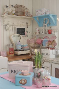 Very vintage pastel kitchen. I love all things pastel!!!