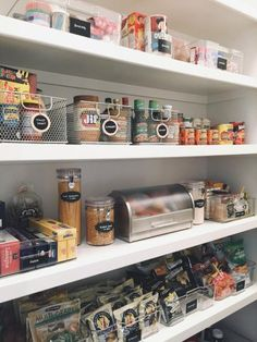"""Here's a trick for making the most of deep shelves from Clea Shearer, cofounder of The Home Edit: Line up boxes and jars of food on top of a bin, basket or serving tray that's not in everyday rotation. """"Pull out the whole container to access anything in the back,"""" she says."""