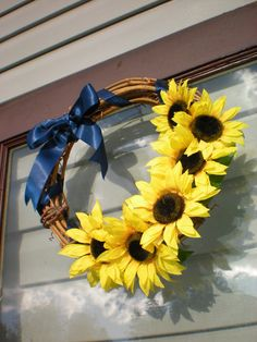 Sunflower summer wreath. I would add a blue/white toile ribbon to this