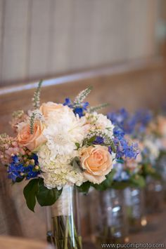 Coral and Blue Bridal Bouquets by Enchanted Florist, Wedding at Loveless Barn.  Photography courtesy of Puccini Photography