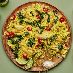 Spiced Coconut Chicken Rice Recipe   Bon Appétit Chicken Rice Recipes, Coconut Chicken, Coconut Rice, Chicken Rice Skillet, Coconut Soup, One Skillet Meals, One Pot Meals, Canned Chickpeas, Spinach Stuffed Chicken