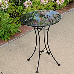 @Overstock - This stylish, versatile, handy little table is glass-topped, so it shimmers in the garden and offers a steady surface. Equally beautiful indoors or out, this table features a black powdercoated finish and is easily portable.  http://www.overstock.com/Worldstock-Fair-Trade/Wrought-Iron-Glass-topped-Looping-Side-Table-Philippines/5797811/product.html?CID=214117 $63.99