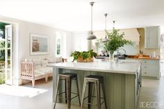 Olive kitchen island with lots of plants