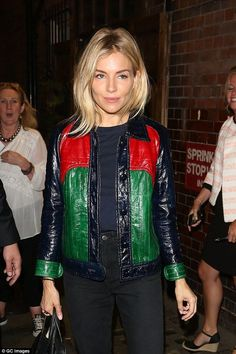 Turning heads: Sienna Miller looked in good spirits as she left the Apollo Theatre in London on Tuesday