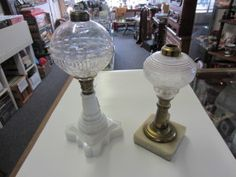 "For our ""Pick"" this week I would like to highlight two wonderful early lamp bases that I have recently put out for sale. The smaller and earlier of the two is cut pressed glass with a  brass stem and marble base. The larger lamp has a lovely milk glass base. This is a great opportunity for a collector with some extra lamp burners to get a early lamp at a reasonable price."