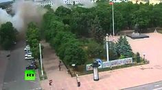 02 July 2014. Military Ukraine's conduct airstrikes in the building of the city administration.  Next to the building going civilians. UN supports these actions.