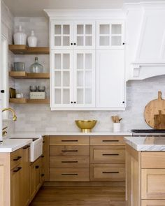 Small Kitchen RemodelBlond oak wood kitchen with marble countertops and simple white upper cabinets. I love the balance of beige wood lower cabinets which add just enough warmth to prevent this white kitchen from looking too much like a hospital! Kitchen Furniture, Kitchen Decor, Kitchen Storage, Kitchen Organization, Rustic Kitchen, Kitchen Tips, Kitchen Interior, Warm Kitchen, Neutral Kitchen