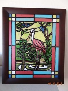 Faux stained glass made with acrylic paint and glue!  Fun tutorial!