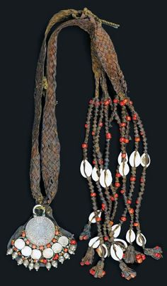 Oman/Yemen | Silver, coral, shell, glass and leather necklace | ca. early 100s