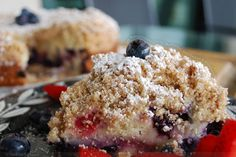 Triple berry crunch cake with blueberries strawberries and blackberries... looks pretty unbelievable