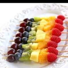 Olivias art party: Rainbow fruit kabobs. Great picnic idea.   Healthy snack (for older kids and adults)