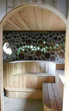 Pompanuck Farm's Cordwood Sauna, built as a community project. Lovely bottle end display as you enter, delicious aroma of cedar log ends and well crafted benches. Diy Sauna, Outdoor Sauna, Outdoor Baths, Saunas, Cordwood Homes, Portable Sauna, Sweat Lodge, Sauna Design, Bottle Wall