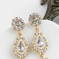 White Drop Gemstone Gold Flower Earrings