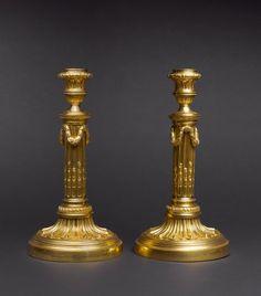 A pair of louis xvi candlesticks