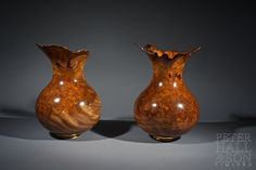 A pair of large Burr Elm Vessels, hand turned and polished to bring out the amazing depth in the wood.