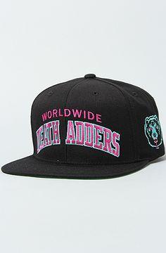 The DA Varsity Snapback Hat in Black by Mishka