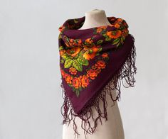 This is a beautiful dark burgundy Russian scarf with lovely orange flowers, and I am sure that there is trumpet creeper among them, which is highly unusual for Russian shawls. I love the warm autumn-like colour scheme. It is beautiful and easy to wear. You can wear it in many ways, and it will always be admired by people around you. This is a small piece of wearable folk art, a timeless Russian classic designed by an artist of the famous Pavlovo Posad Manufacture. Despite its modest size…