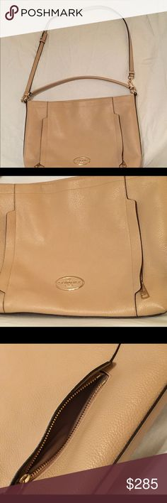 """Coach - Pebbled leather beige shoulder bag. Exterior has 2 additional zip pockets for quick go to for you.  Interior has zip pocket, 2side pockets, plenty of storage for all your products and gadgets.  No marks or scratches. Comes from a smoke free home.  Adjustable strap for tall or short ladies.  The strap can be removed as well for additional fashion styles.  Measures 13""""(L)x12""""(H)x3""""(W) Coach Bags Shoulder Bags"""
