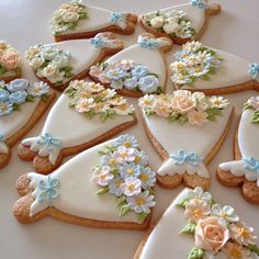 white dress cookies w/ beautiful sugar flowers