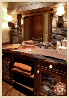 beautiful cozy rustic decor bathroom. I love the countertop and stone wall!