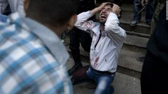 A Syrian man mourns the death of his father, who was killed during a government attack in Aleppo on October 10.