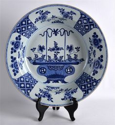 AN EARLY 18TH CENTURY CHINESE BLUE AND WHITE PORCELAIN BASIN Yongzheng/Qianlong, painted with urns of precious objects. 1Ft 2.5ins diameter.