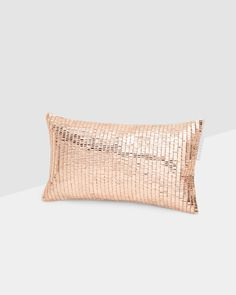 Not necessarily to cover s whole bed/sofa with, but as an accent this metallic cushion could look beautiful! Metallic cushion - Rose Gold   Ted Baker UK