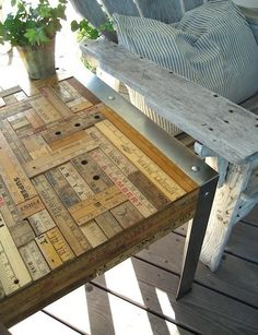 Porch table coverd in old yardsticks