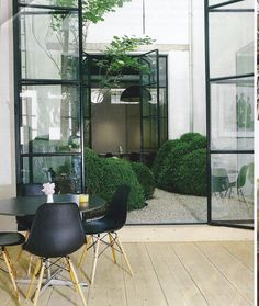 Metal doors, Interior courtyard. Eames, Little Gardens, Garden, Chairs