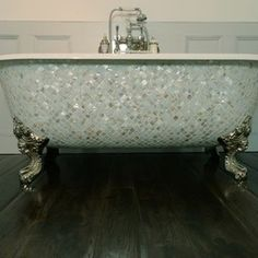 Bathe In Style With This Gorgeous Tub Decked Marble Decor And Fancy Plumbing Fixtures