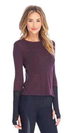 With an open racerback, impeccable style lines, mesh color blocking, and thumbholes, this street chic long sleeve tee has left no detail unturned. Layer it over our Element Bra and a pair of leggings when heading out for your early morning workout.