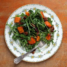 Arugula Salad with Roasted Butternut Squash, Cranberries, and Candied Pecans by Saveur. This sweet-tart winter salad is a simple way to add elegance to a weeknight dinner. The recipe comes from The Hadassah Everyday Cookbook: Daily Meals for the Contemporary Jewish Kitchen (Rizzoli, 2011) by Leah Koenig.