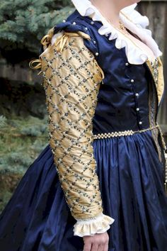 wowza Beautiful beadwork on the sleeve and bodice; the gold aglets on the ribbons are a nice touch as well