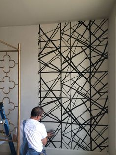 Kelly Wearstler's Channel print wallpaper in Ebony & Ivory. Needs to happen.