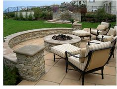 I like this!! Nice simple patio with a  raised firepit. This would be cute in the back yard.