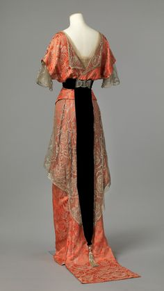 c. 1914 Evening Gown of machine woven binding patterned silk fabric with silver thread, details of machine lace, tulle, silk fabric, plain weave, velvet and satin.