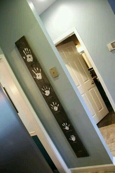every couple years redo your kids hand print to make a time line.