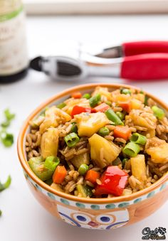 Pineapple Fried Rice with onion, carrots, peas, bell peppers & juicy pineapple chunks! [Vegan]