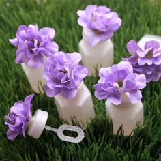 Delphinium Wedding Bubbles - get cheap bubbles and glue flowers on the tops, add a sign with instructions next to programs