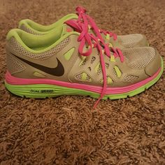 Nikes Lime green and hot pink and silver nikes, barely worn they show size 5.5y but I'm a size 7 and they fit me pefect. Nike Shoes Sneakers
