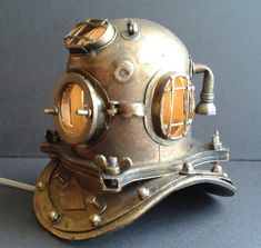 A Scuba Diver's Lamp – This sure to be a good conversation piece. Have this in your home to give it an old school vintage look with this custom made Scuba diver lamp. Well crafted scuba diving helmet, that it looks like it sure somewhere display in the Smithsonian museum. Item is not for sale or is sold A Scuba Divers Lamp #diverlamp #goodconversationpiece #scubadiverlamp