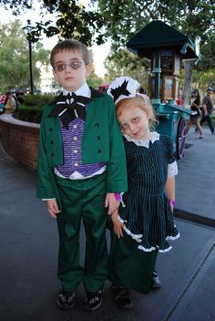 Adorable little children dressed as hosts from The Haunted Mansion..Disneyland and Walt Disney World.