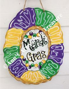 This article is not available King Cake Mardi Gras Door Hanger Parades NOLA New Orleans Mardi Gras Centerpieces, Mardi Gras Decorations, Mardi Gras Wreath, Mardi Gras Party, Hanger Crafts, Diy Crafts, New Orleans King Cake, King Cake Baby, Great Christmas Presents