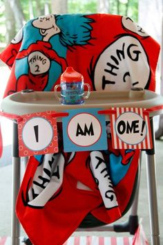 Amazing Dr. Suess party! I WANT that blanket on the high chair!