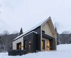 FIRM: CARGO Architecture; PROJECT: Villa Boréale; LOCATION: Charlevoix Regional County Municipality, QC, Canada. Charming contemporary cottage sited on a sloped area and at the heart of a boreal forest, setting up beautiful views, skiable opportunities and strategic design to let in natural light and interplay between the interior and exterior spaces.